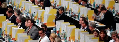 Delegates vote behind portable cardboard voting cabins during a congress of Germany's conservative Christian Democratic Union (CDU) party on December 7, 2018 at a fair hall in Hamburg