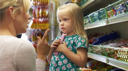Uk bbc news a child picking up chocolate from a supermarket shelf fandeluxe Gallery
