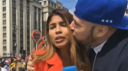 102141789 dw harassment - 【サッカーW杯】女性レポーター生放送中にセクハラ受ける 体触られキスも  「こんな行為は許されない」
