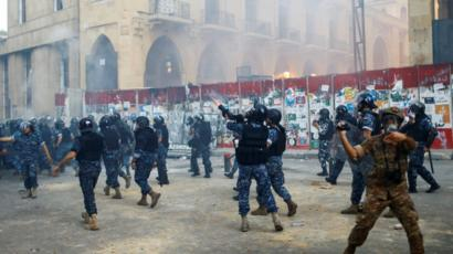 Riot police fired weapons during anti-government protests in Beirut