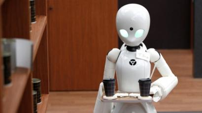 Japanese cafe uses robots controlled by paralysed people