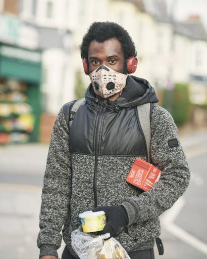Man in a mask with his shopping