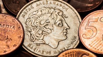Moneda antigua con el rostro de Alejandro Magno