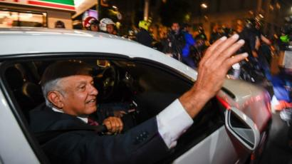 Presidential candidate Andres Manuel Lopez Obrador waves to supporters in Mexico City on July 1, 2018