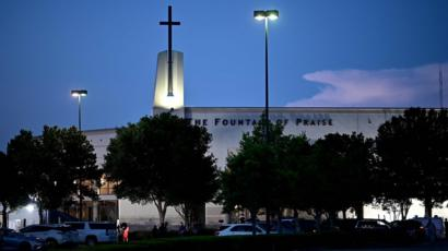 Media set up in front of the Fountain of Praise church where services will be held for George Floyd on 8 June in Houston, Texas