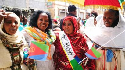 Women with flags in Asmara