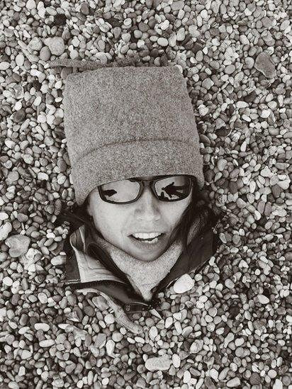 Woman buried on the beach