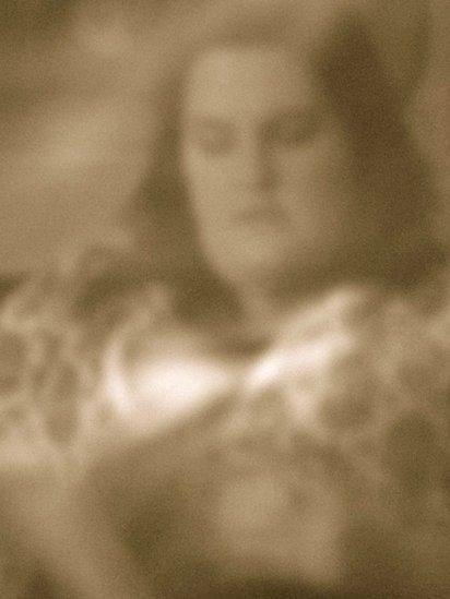 Pinhole photo of a woman