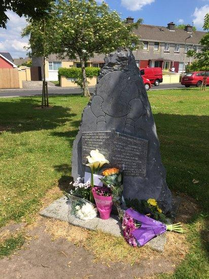 Floral tributes have been laid at the site of Ali's former ancestral home in Ennis
