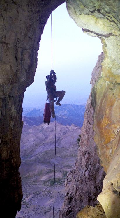 Abseiling to the cave