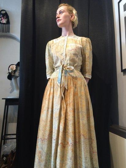 Silk map dress modelled by Harriet Dakin