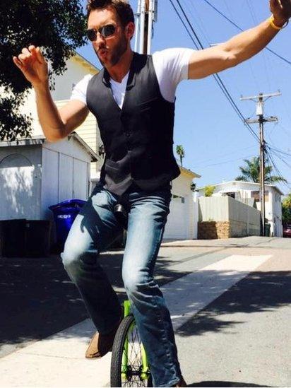 Chad Mureta on a unicycle