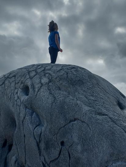 Ailsa standing on a boulder