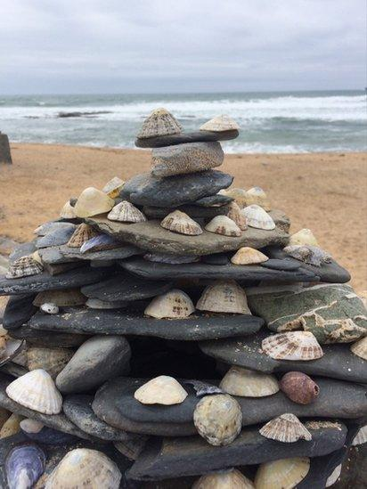 Stone and shell tower on a beach