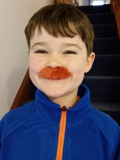 Boy wearing a moustache