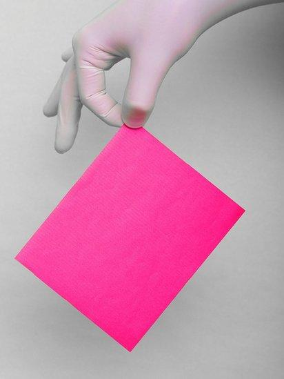 Hand holding a piece of paper
