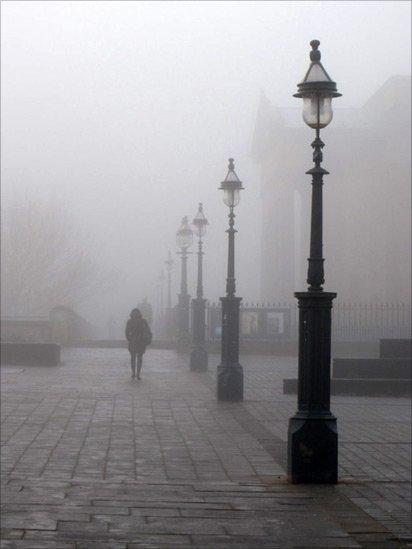 People walking through mist