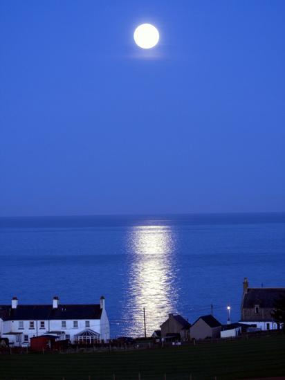 The moon shining over Collieston, Aberdeenshire