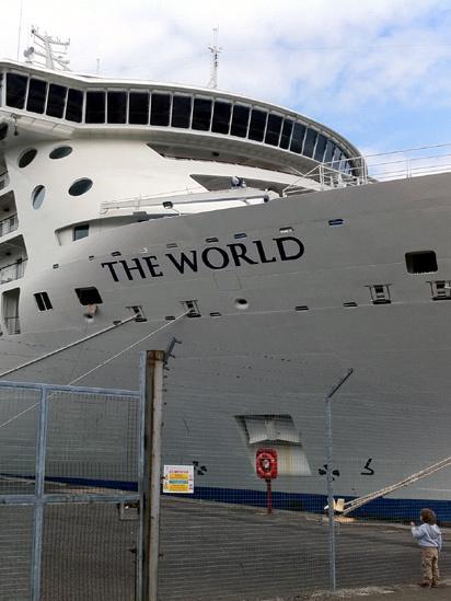 Boy looking at a cruise ship