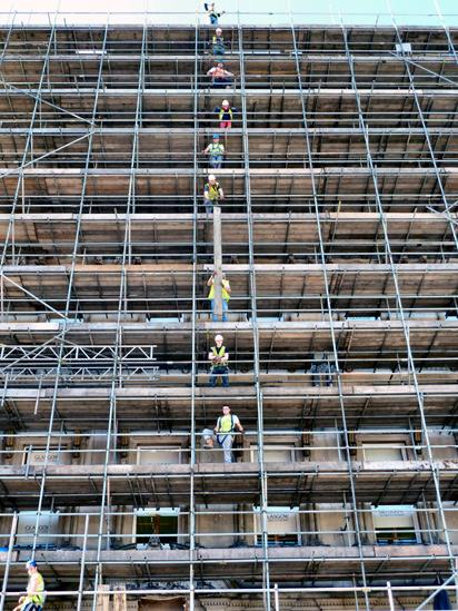 Workers putting up scaffolding