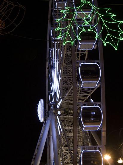 A big wheel lit up at night