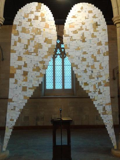 Angel's wings made of envelopes