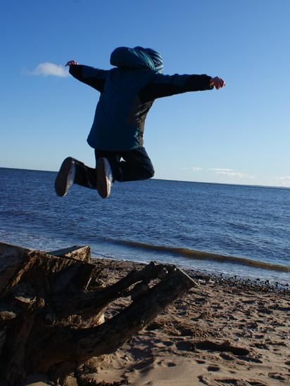 Ethan jumping on the beach