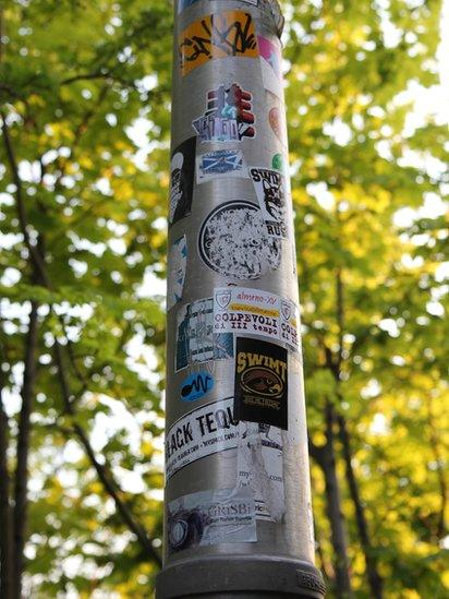 Stickers on a lamp post