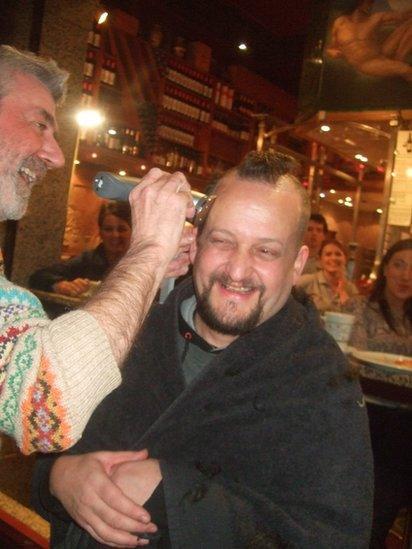 Man having his head shaved
