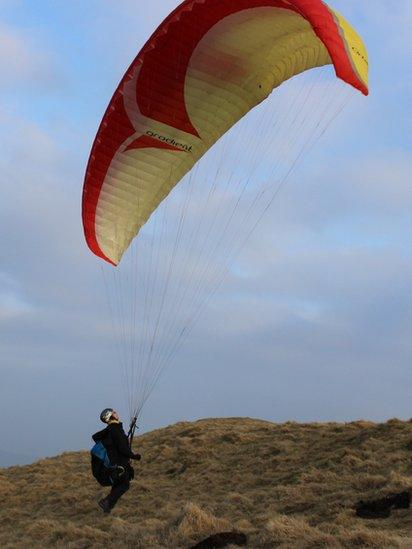 Paraglider getting ready for take-off