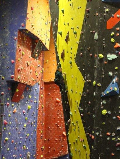 Naomi on climbing wall at Transition Extreme