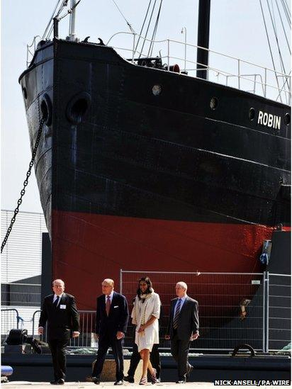 The Duke of Edinburgh, (second left) during a visit to inaugurate the SS Robin's new permanent home in Royal Victoria Dock, east London