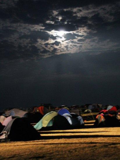 Moonlight over a campsite