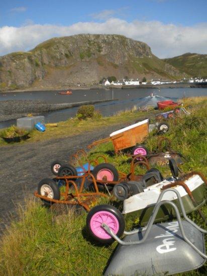 Overturned wheelbarrows by the roadside
