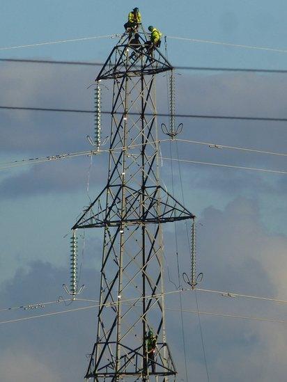 Engineers working on a pylon