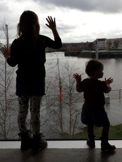 Children looking out of window