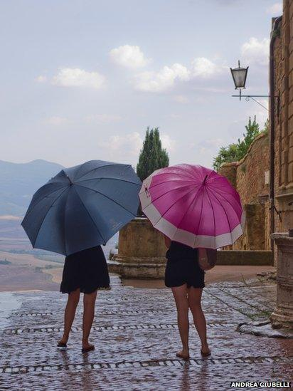 Two young tourists are looking at the landscape in Tuscany