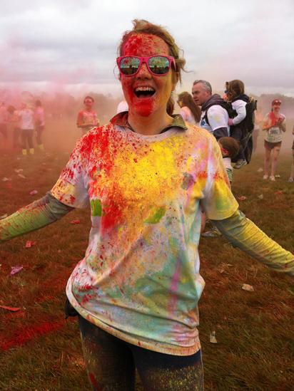 Woman covered in coloured powder