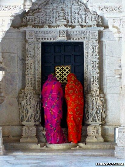 Women looking in to temple