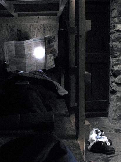 Woman reading a map inside a bothy