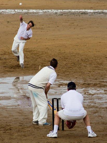 Cricket match on beach