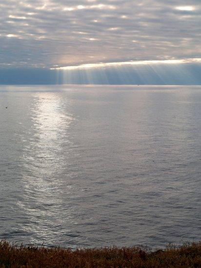 Rays of sunshine streaming through the cloud