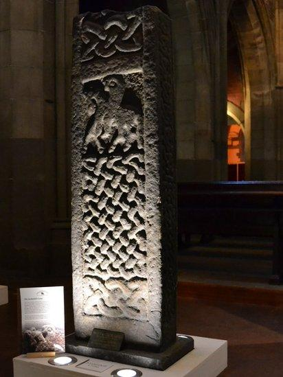 The recumbent stones, which often show hunting scenes and interlace patterns, were designed to be placed over a burial coffin