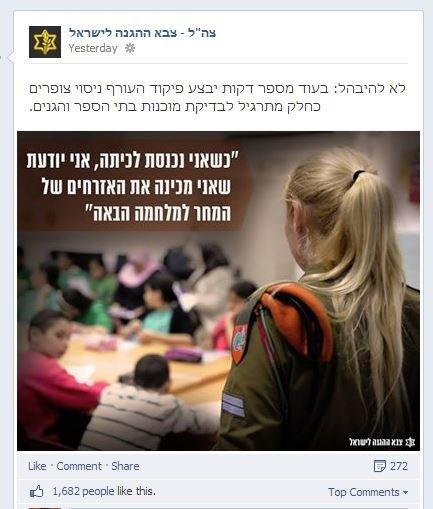 Female soldier addresses classroom