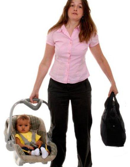 Woman carrying baby in car seat