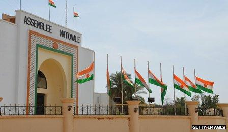 Flags flying at half-mast in honour of migrants who died in a desert crossing