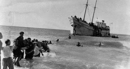 Jewish refugees arrive near Haifa aboard the SS United Nations in February 1948