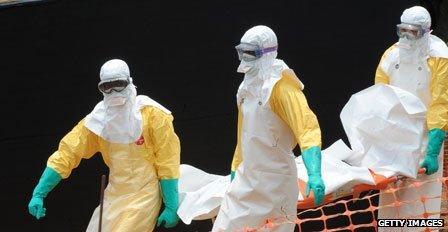 Medics remove body of a victim of the Ebola virus
