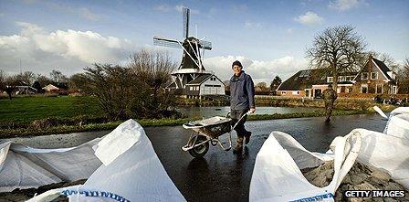 A Dutch resident prepares against flooding