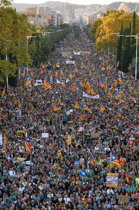 People gather during a pro-independence demonstration called by Catalan National Assembly (ANC) and Omnium Cultural organisations, against the conviction of Catalan separatist leaders for the 2017 attempted secession, in Barcelona, on October 26, 2019